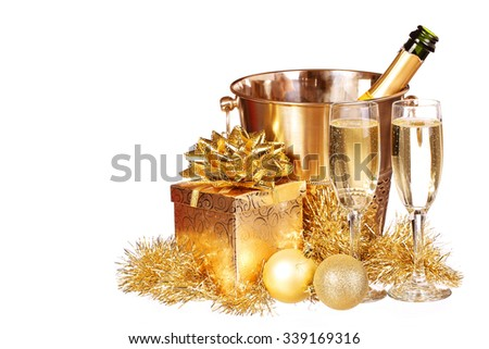 Christmas or New Year's Eve. Champagne and Gold Presents isolated on white. Celebration