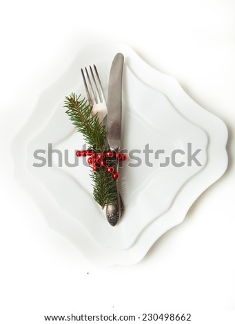 Christmas or New Year table setting with blue plates and red strip and with twigs Christmas tree. Top view  - stock photo