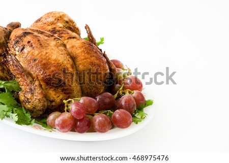 Christmas or thanksgiving roasted turkey with grapes and herbs isolated on white background