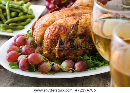 christmas or thanksgiving turkey dinner on rustic wooden background
