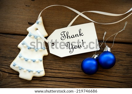 Christmas or Winter Background with Christmas Tree Cookie and Blue Chrismas Balls and a Label on which stands Thank You - stock photo
