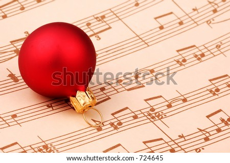 Christmas Ornament and Sheet Music - stock photo