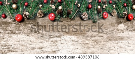 Christmas ornament bordering an old wooden plank