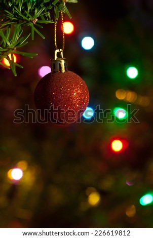 Christmas ornament hanging on a branch. Selective focus, shallow DOF. - stock photo