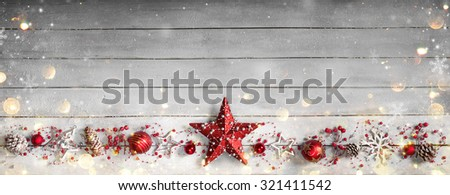christmas ornament in row on vintage wooden plank  - stock photo
