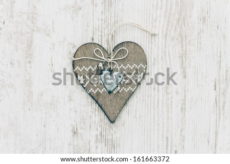 Christmas Ornament on White Wooden Background. Heart. Rustic - stock photo