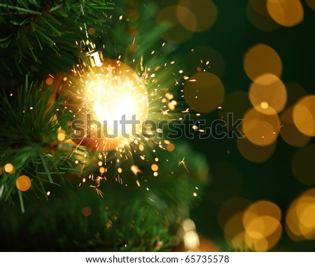 christmas ornament with fireworks - stock photo