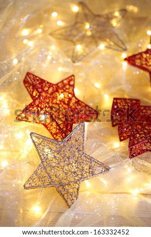 Christmas ornaments and garland on bright background close-up