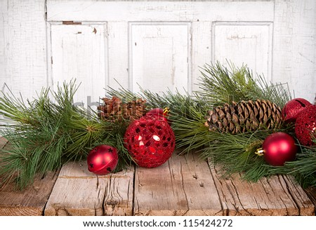 Christmas ornaments and pine branches on wooden background - stock photo