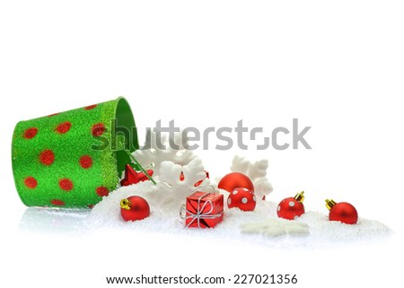 Christmas ornaments and snow coming out of a bucket - stock photo