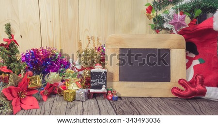 christmas ornaments christmas ornaments and Chalkboard on wood background. - stock photo