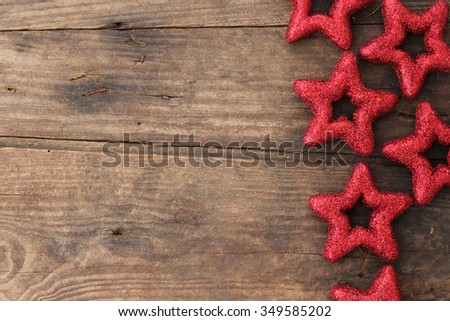 Christmas ornaments - glittering star on rustic wooden background - copy space - stock photo