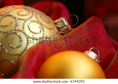 Christmas Ornaments / Gold ball and ribbon on a red background