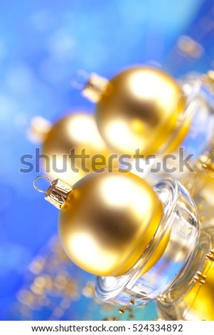 Christmas ornaments - Golden baubles on blue background