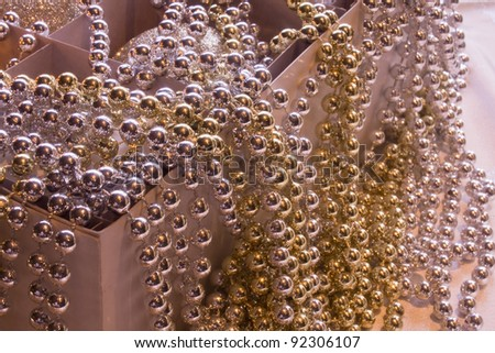 Christmas ornaments in a box, which much shining pearl covers, - stock photo