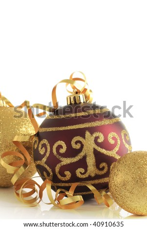 Christmas ornaments in gold and burgundy. - stock photo