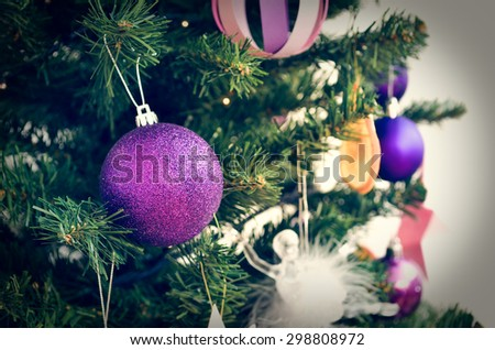 Christmas Ornaments on a green Christmas Tree in retro filter effect or instagram filter - stock photo