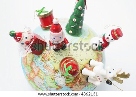 Christmas Ornaments on Globe - stock photo