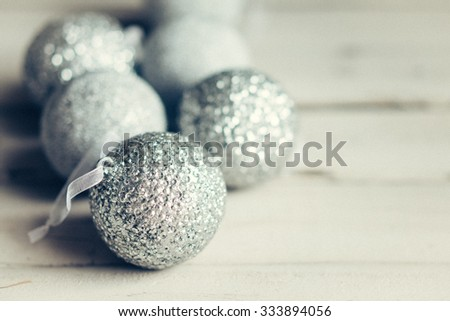 Christmas ornaments on rustic wooden background - stock photo