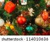 Christmas ornaments on tree - stock photo