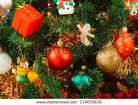 Christmas ornaments on tree - stock photo