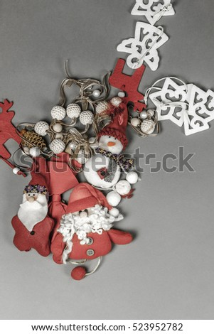 Christmas ornaments placed in smooth grey background. Copy space