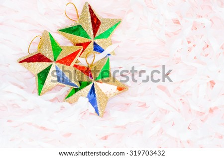 Christmas ornaments three stars on christmas decorations. tinsel - stock photo