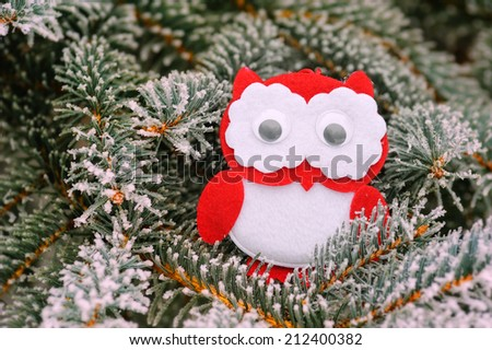 Christmas owl on a snowy tree in winter
