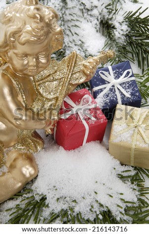 Christmas parcels and Christmas angel, close up - stock photo
