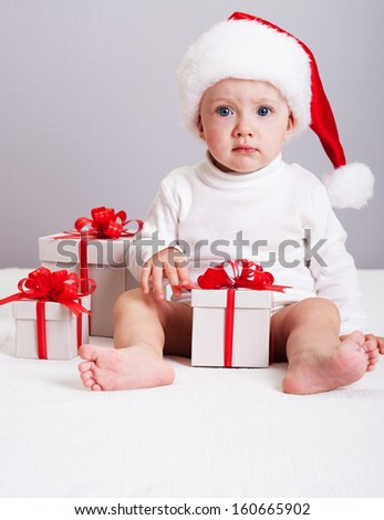 Christmas photo.  Baby with gifts.