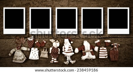 Christmas photo frames cards, five empty instant photo frames hanging on an old wooden wall - stock photo