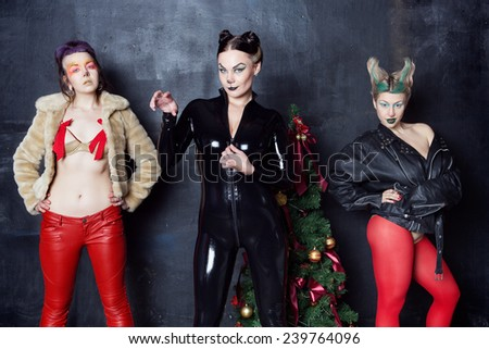 Christmas photo session the girls in makeup in the photo studio - stock photo