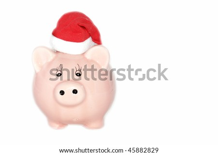 Christmas piggy bank with white space - stock photo