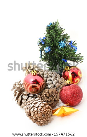 Christmas Pine Cone with Christmas balls and tree isolated on white - stock photo