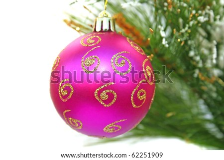 Christmas pink ball and fir tree on white background. - stock photo