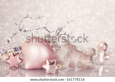 Christmas pink decoration with balls and ribbon - stock photo