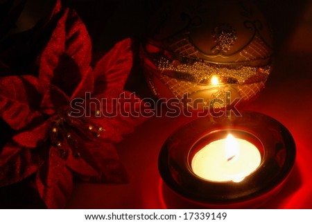 christmas poinsettia and candle - stock photo