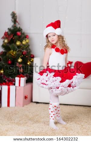 Christmas portrait of beautiful curly girl - stock photo
