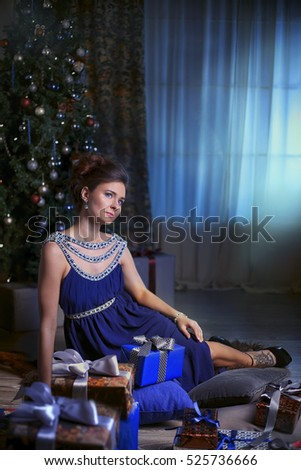 Christmas portrait of beautiful woman in blue light
