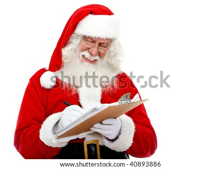 Christmas portrait of Santa Claus writing a list isolated over a white background - stock photo