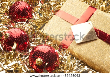Christmas present and beautiful gold red christmas setting with baubles - stock photo