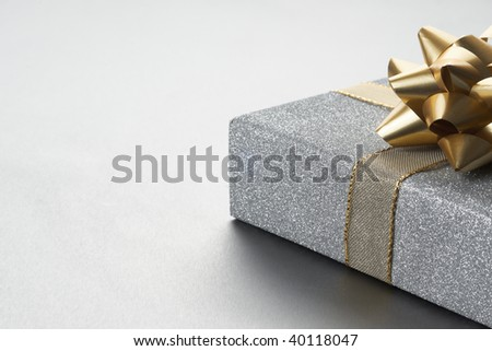 Christmas present beautiful silver setting with space for copy - stock photo