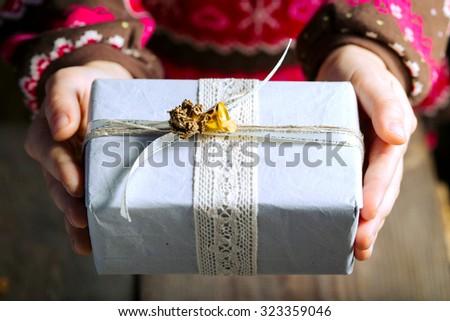 christmas - present in children's hands - stock photo