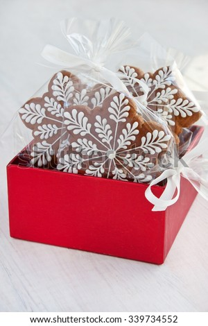 Christmas present in gift box, gingerbread cookies with decoration   - stock photo