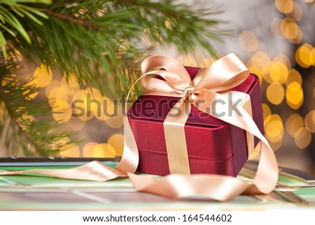 Christmas present piled underneath a christmas tree - stock photo