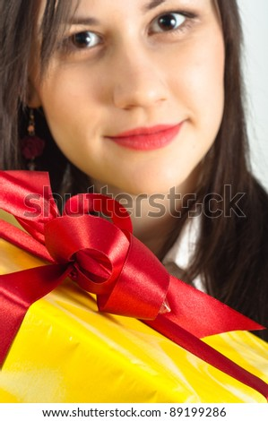 Christmas present with a beautiful girl in the background - stock photo