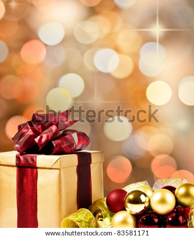 Christmas Present with decorative xmas bubbles and ribbon (gold, red and green)