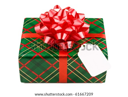 Christmas present with red bow and gift tag. - stock photo