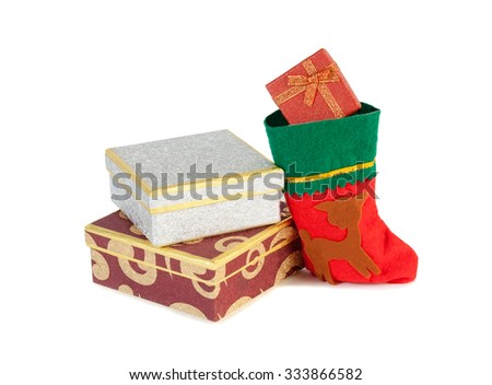 Christmas presents and christmas sock isolated on white - stock photo