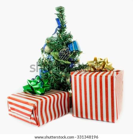 Christmas presents and christmas tree isolated - stock photo